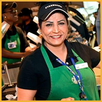 Smiling woman working at Starbucks