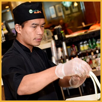Man working at a Sushi restaurant
